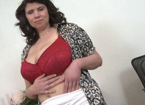 Huge breasted Mature lady playinbg with her pussy