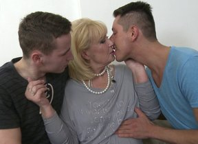 Horny housewife shafting and sucking two guys..