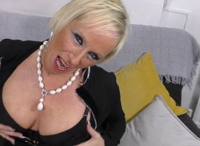 Horny shaved British housewife playing with..