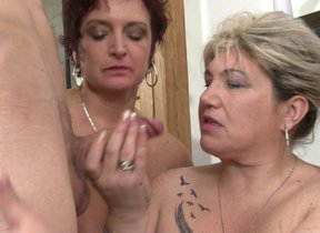 One lucky guy having funwith three mature sluts