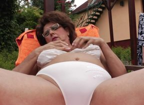 Mature momma enjoys the pool and say no to hairy..