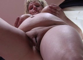 Naughty full-grown slut playing with herself on..