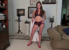 This naughty mom gets undressed with an..