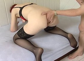Mature redhead fucked by a young male and made..