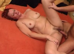 Mature redhead feels a middle of inches more her..