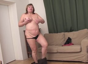 Chunky grown up woman strips naked with the..
