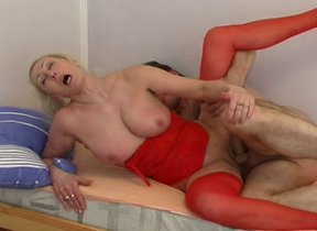 Mature with respect to red skivvies gets pussy..